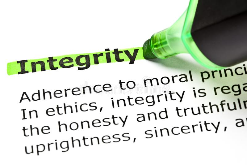 Integrity Dictionary Definition Green Text Marker. Dictionary definition of the word Integrity highlighted in green with felt tip pen stock images