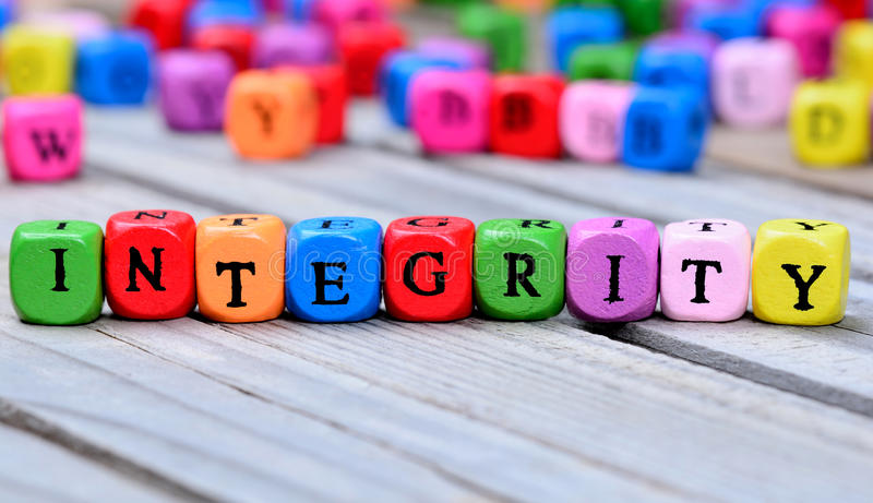 Integrity word on table. Integrity word on wooden table stock photography