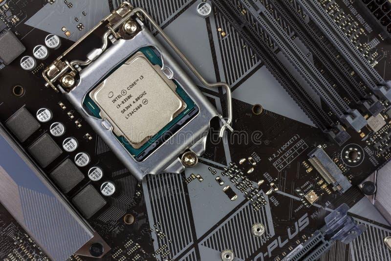 Intel core I3 desktop processor 8th gen on the motherboard Asus closeup top view stock photos
