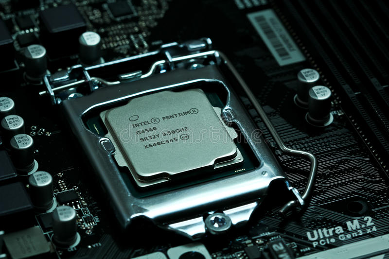Intel CPU installed on a motherboard stock photos