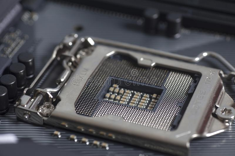 Intel LGA 1151 cpu socket on motherboard Computer PC. Close up royalty free stock photos