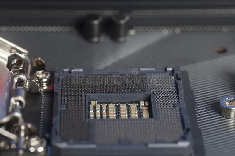 Intel LGA 1151 cpu socket on motherboard Computer PC. Close up royalty free stock image