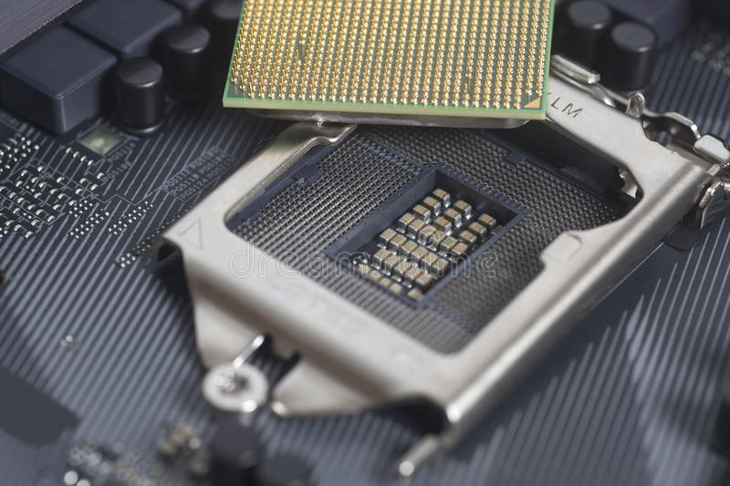 Intel LGA 1151 cpu socket on motherboard Computer PC with cpu pr. Ocessor close up stock images
