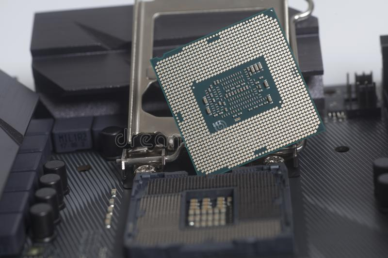 Intel LGA 1151 cpu socket on motherboard Computer PC with cpu processor. Close up stock images