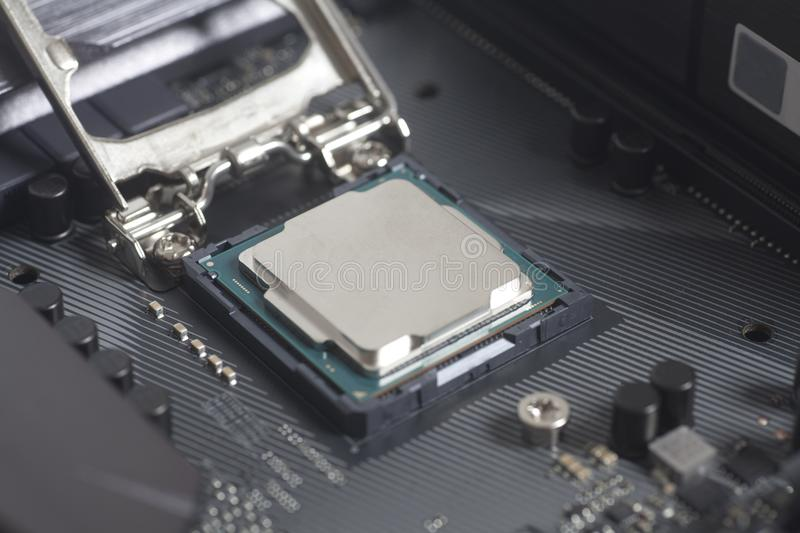 Intel LGA 1151 cpu socket on motherboard Computer PC with cpu processor. Close up stock photo