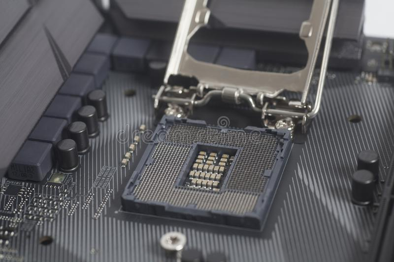 Intel LGA 1151 cpu socket on motherboard Computer PC. Close up royalty free stock photography