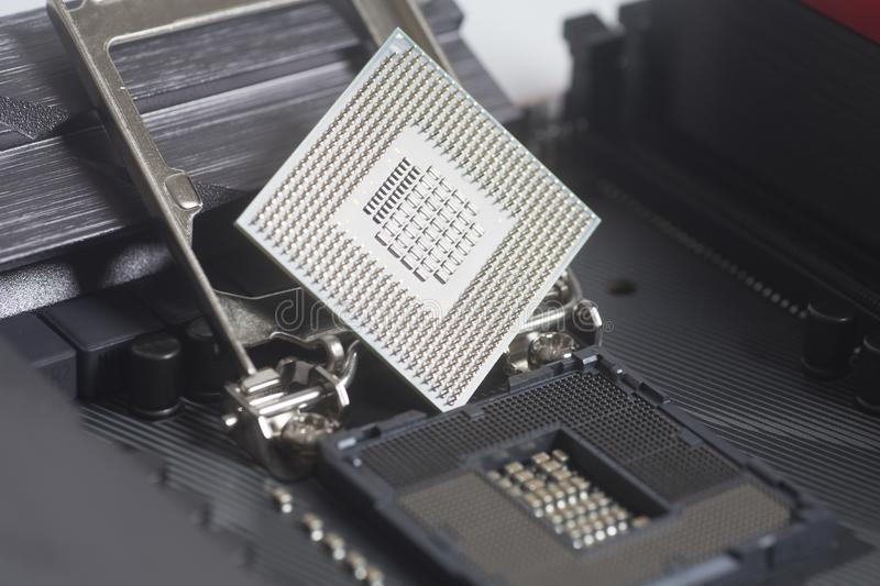 Intel LGA 1151 cpu socket on motherboard Computer PC with cpu processor. Close up stock image