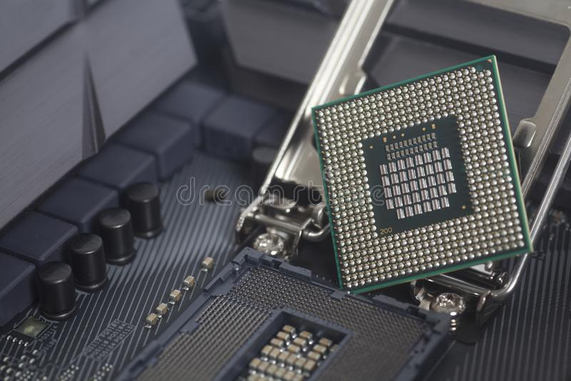 Intel LGA 1151 cpu socket on motherboard Computer PC with cpu processor. Close up royalty free stock photography