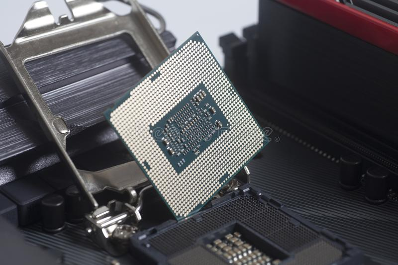 Intel LGA 1151 cpu socket on motherboard Computer PC with cpu processor. Close up royalty free stock image