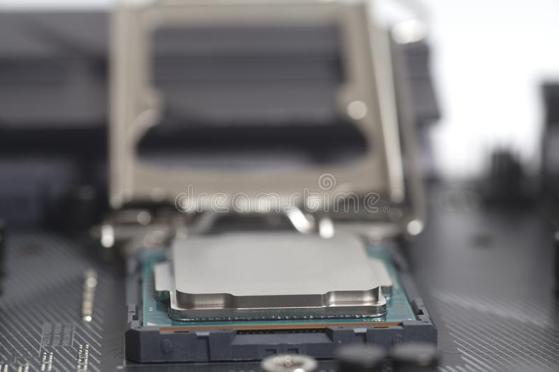 Intel LGA 1151 cpu socket on motherboard Computer PC with Processor. Close up royalty free stock photo