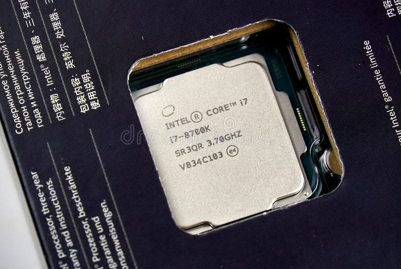 Intel logo and CPU. MONTREAL, CANADA - DECEMBER 8, 2018: Intel CPU central processor unit i7 8th generation in a box. Intel is an American multinational royalty free stock photos