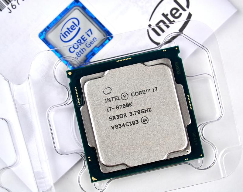 Intel logo and CPU. MONTREAL, CANADA - DECEMBER 8, 2018: Intel CPU central processor unit i7 8th generation in a box. Intel is an American multinational royalty free stock images