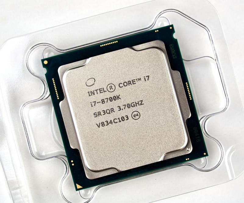 Intel logo and CPU. MONTREAL, CANADA - DECEMBER 8, 2018: Intel CPU central processor unit i7 8th generation in a box. Intel is an American multinational stock images