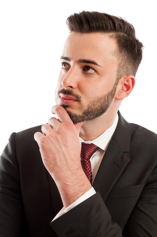 Inteligentny biznesowego mężczyzna główkowanie zdjęcia stock