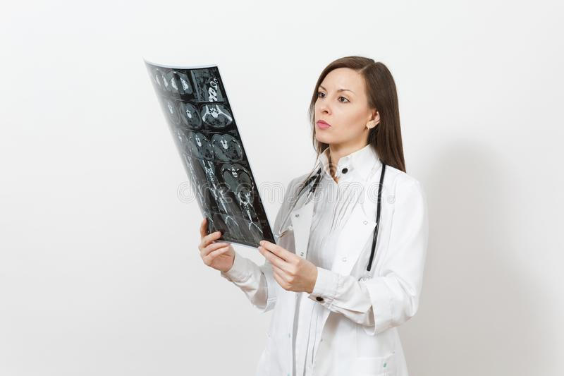Intellectual doctor woman holds x-ray radiographic image ct scan mri isolated on white background. Female doctor in royalty free stock photography