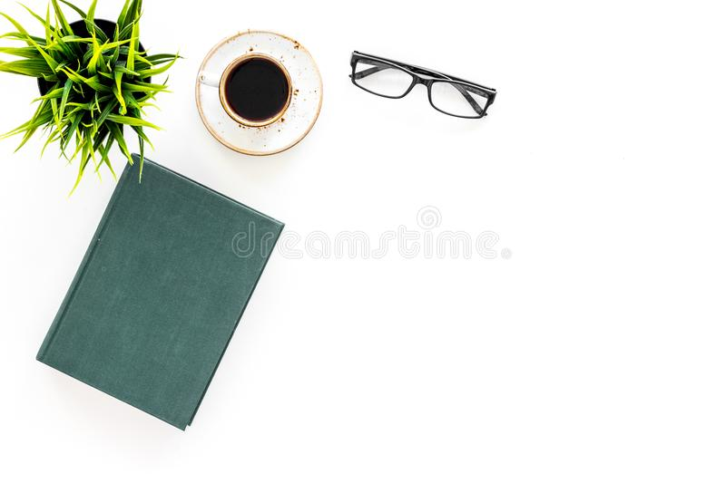 Intellectual entertainment concept. Books with empty cover near glasses, coffe, plant on white desk top view space for. Intellectual entertainment concept. Books royalty free stock photography