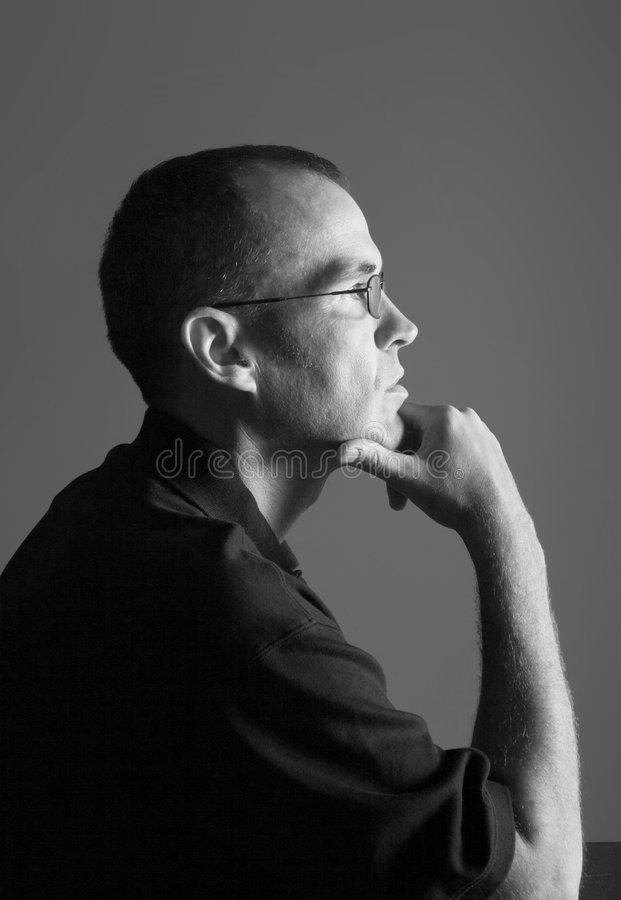 Intellectual man. Intelligent looking man in classic thinker pose royalty free stock photos
