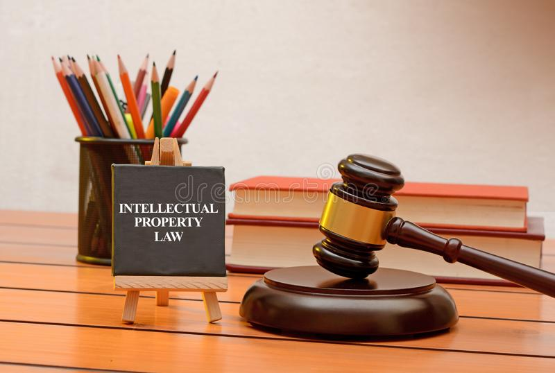 Intellectual property law conceptual photo with books in background.  stock photo