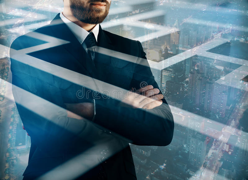 Intelligence concept multiexposure. Thoughtful young businessman on abstract city background with maze, labyrinth. Intelligence concept. Double exposure royalty free stock image