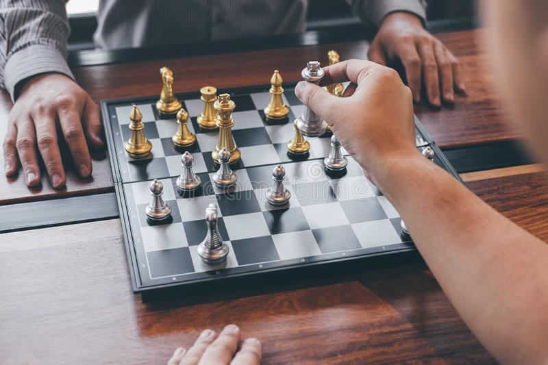 Intelligent businessman playing chess game competition with the opposite team, planning business strategic to development for win. And success, Gold and silver royalty free stock photography