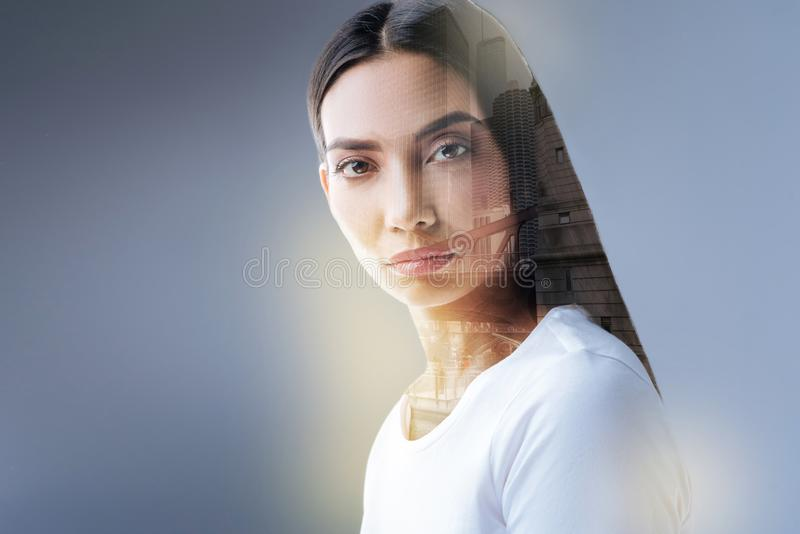 Intelligent charming woman reaching beyond horizon. Urban connection. Gorgeous positive concentrated woman posing on the isolated background while presenting royalty free stock photos
