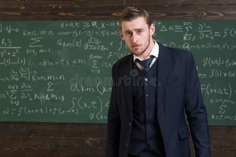 Intelligent man in suit standing in classroom. Aristocrats and elite concept royalty free stock photography