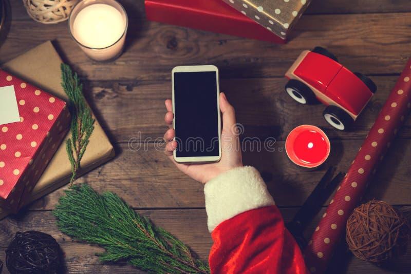 Intelligenter Telefonspott Sankt-Gebrauches oben mit einem copyspace für Weihnachten lizenzfreie stockfotografie