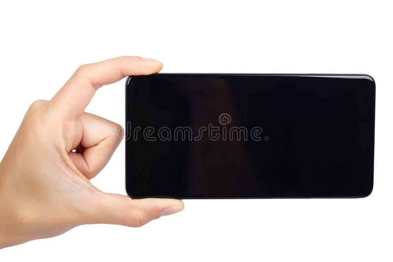 Intelligentes Telefon mit dem leeren Bildschirm in der Hand lokalisiert auf weißem Hintergrund, großes Mobile, schwarzes Mobiltel lizenzfreie stockfotos