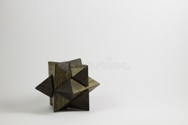 Intelligenza a forma di stella di puzzle di legno fotografia stock