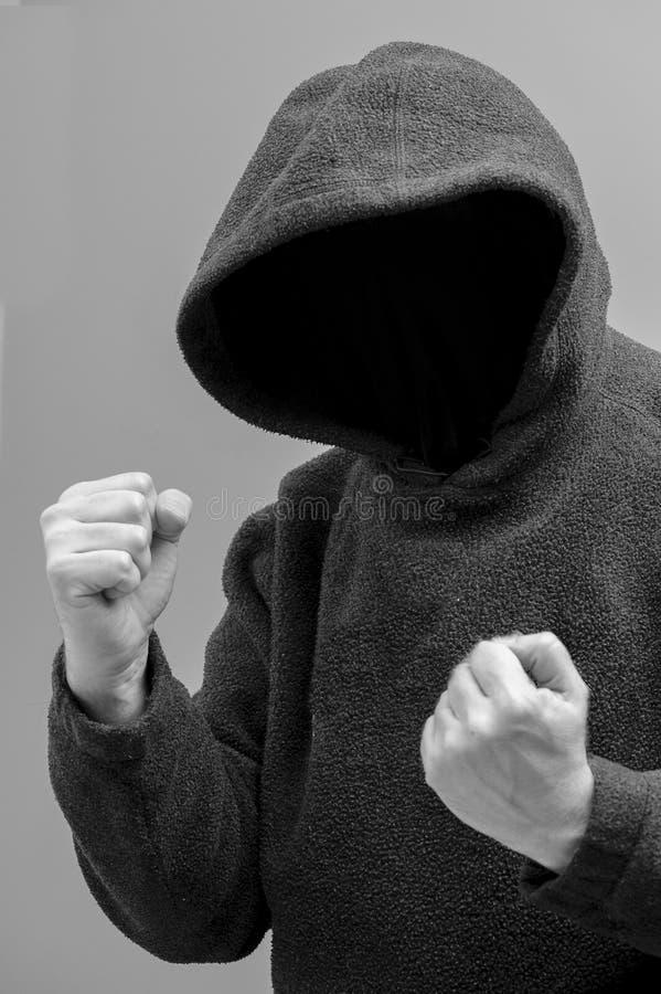 Intenção encapuçado do homem na violência fotografia de stock royalty free