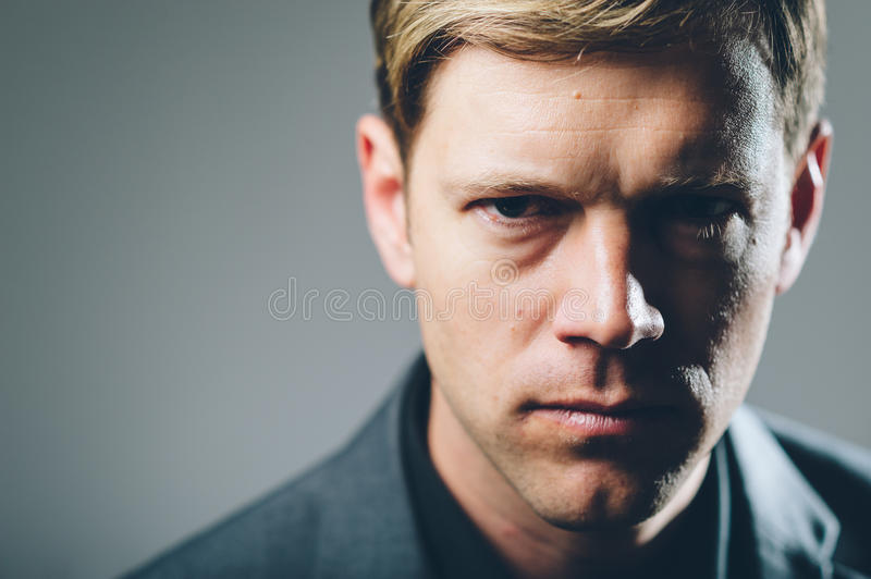 Intense stare businessman portrait. A young businessman with an intense stare stock photography