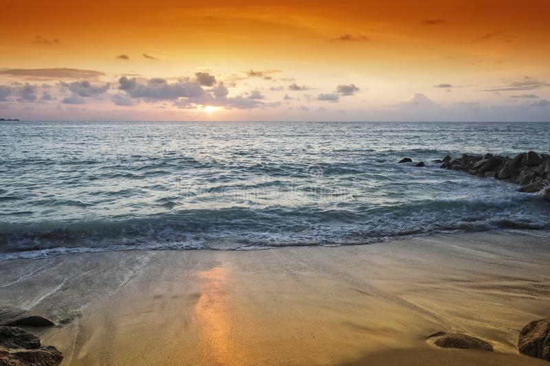 Golden sunset over tropical beach royalty free stock photo