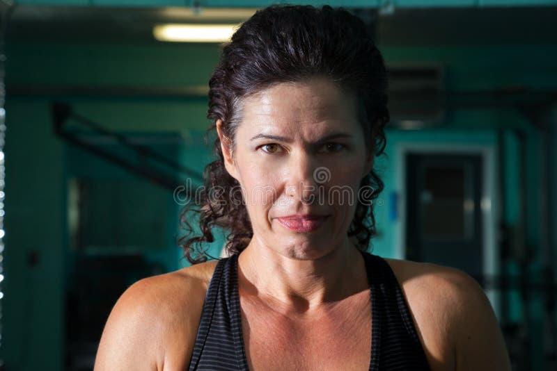 Intense Woman Headshot Split Light royalty free stock image