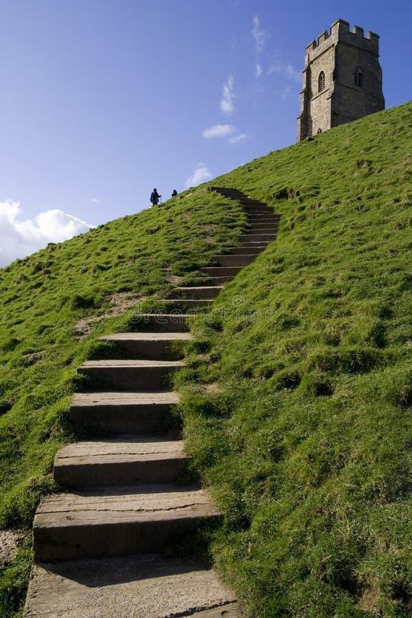Intensifie au massif de roche glastonbury photos stock