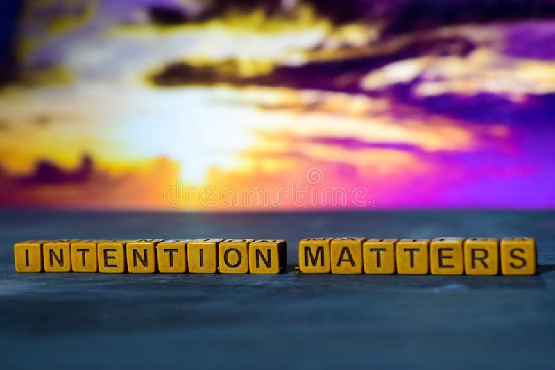 Intention matters on wooden blocks. Cross processed image with bokeh background stock photos