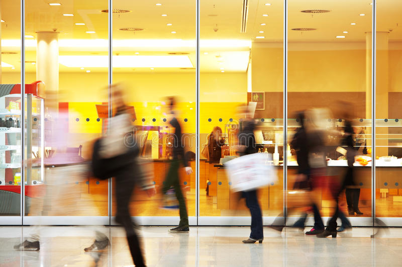 Intentional Blurred Image of People in Shopping Center. People silhouettes in motion blur