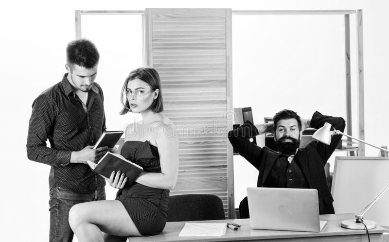 Intentional sexual provocation. Woman attractive lady working with men colleagues. Office atmosphere concept. Sexual royalty free stock images