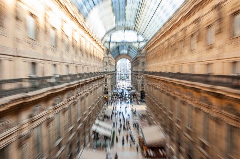 Intentionally blurred abstract view of Galleria Vittorio Emanuele II with people shopping in Milan, Italy. stock image