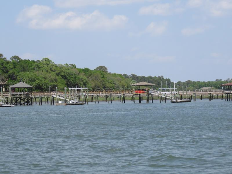 Raised walkways and docks along a shoreline. The Inter Coastal Waterway along Hilton Head Island experiences significant changes in the level of the water, as royalty free stock images