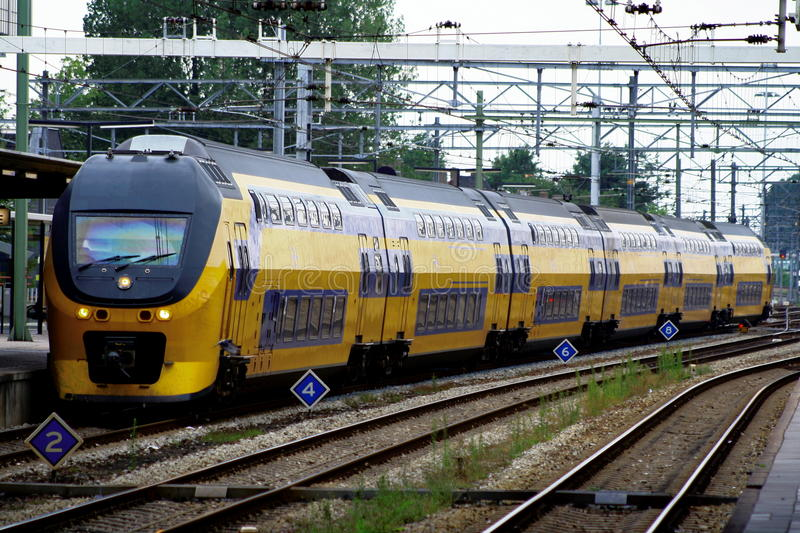 Intercity train at platform Railwaystation Utrecht, Holland, the Netherlands. Intercity train coming in at NS Railwaystation Utrecht, Holland, the Netherlands royalty free stock photography