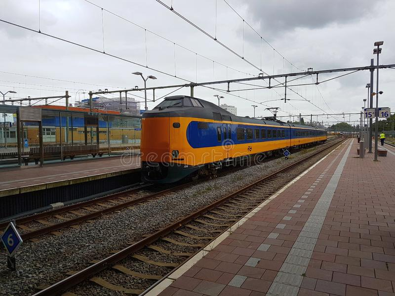 .Intercity train type ICM koploper at railroad track along platform at Rotterdam Centraal Station stock image
