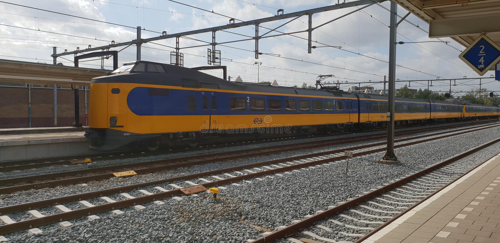 Intercity train type koploper running into station of Gouda along the platforms in the Netherlands. royalty free stock images