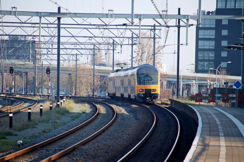 Intercity type DDZ double decker at railroad track at train station Den Haag Ypenburg in The Hague in the Netherlands. royalty free stock photo