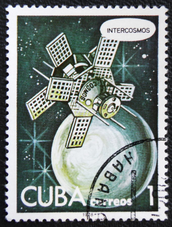 Intercosmos satellite orbiting a planet in space, circa 1978. MOSCOW, RUSSIA - JANUARY 7, 2017: A stamp printed in Cuba shows an Intercosmos satellite Cosmos stock images