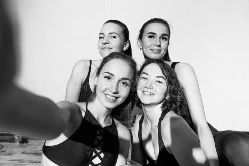 Interest and fitness concept. positive sportswomen taking a photo. After workout. entertainment. black and white photo royalty free stock image