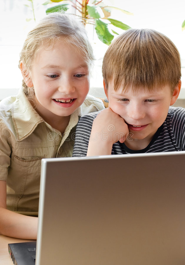 Interested boy and girl with notebook stock photo