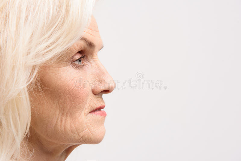 Interested glance of matured woman stock photo