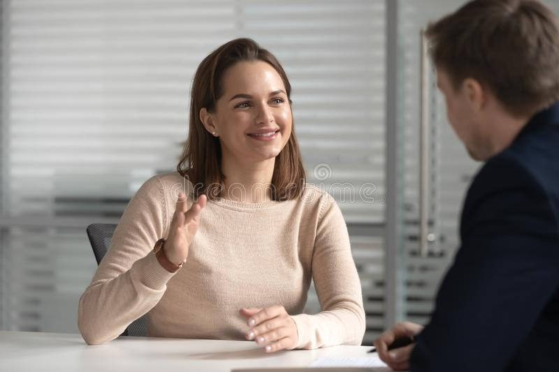 Interested hr male manager holding job interview with female candidate. royalty free stock photos