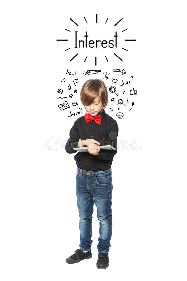 Interested little boy. Little boy with the phone on a white background stock photo