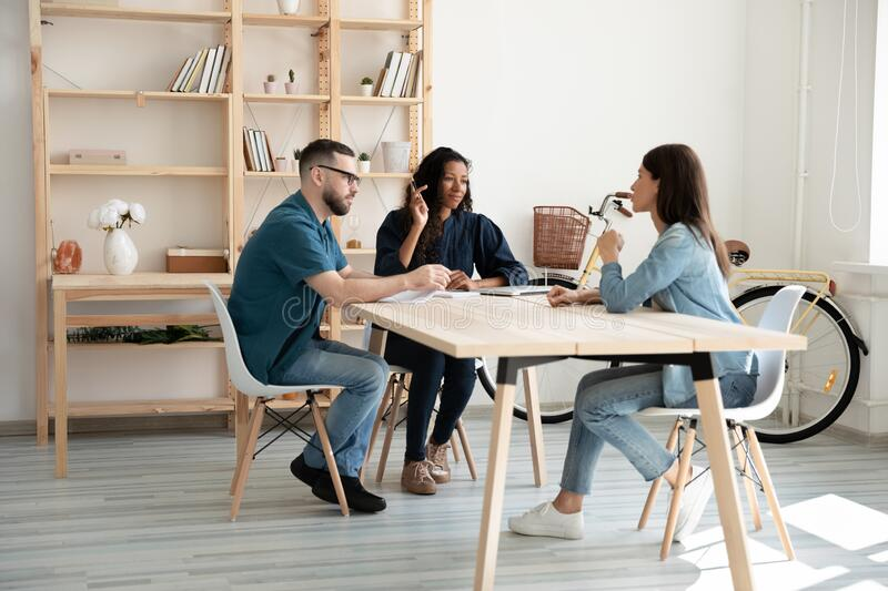 Interested mixed race female male hr managers listening to applicant. royalty free stock image